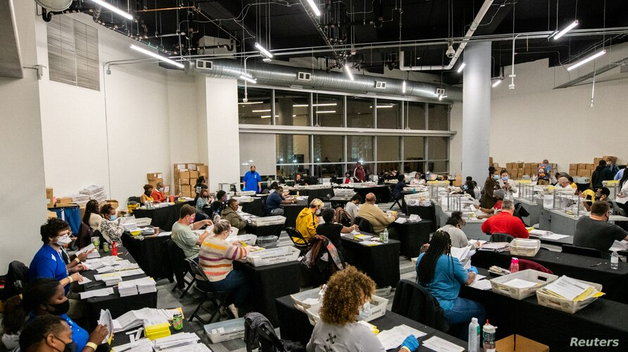 Employees of the Fulton County Board of Registration and Elections process ballots in Atlanta, Georgia U.S., November 4, 2020…