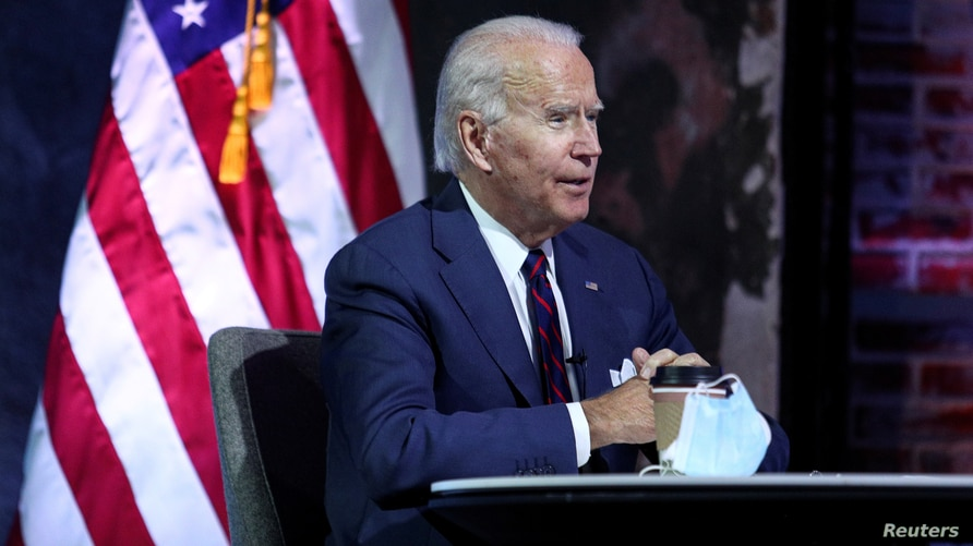 FILE PHOTO: U.S. President-elect Joe Biden receives a national security briefing in Wilmington, Delaware, U.S., November 17,…