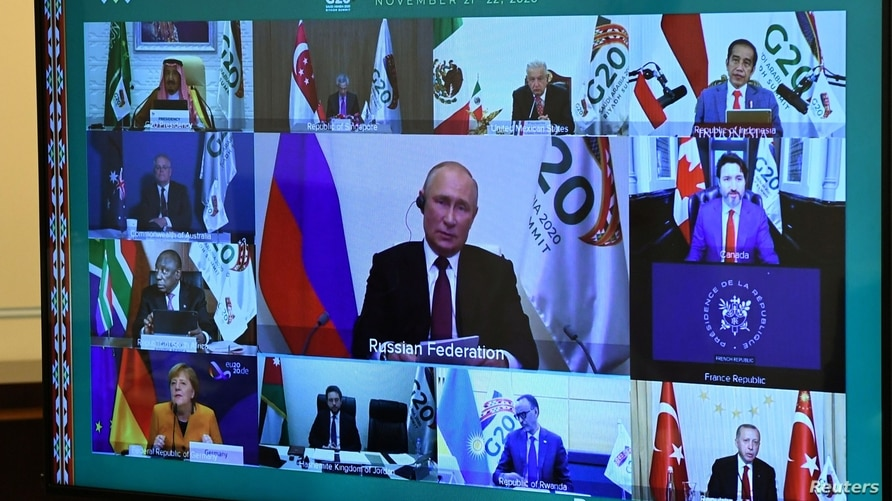 Russian President Vladimir Putin takes part in a video conference during the G20 Leaders' Summit 2020, at the Novo-Ogaryovo…