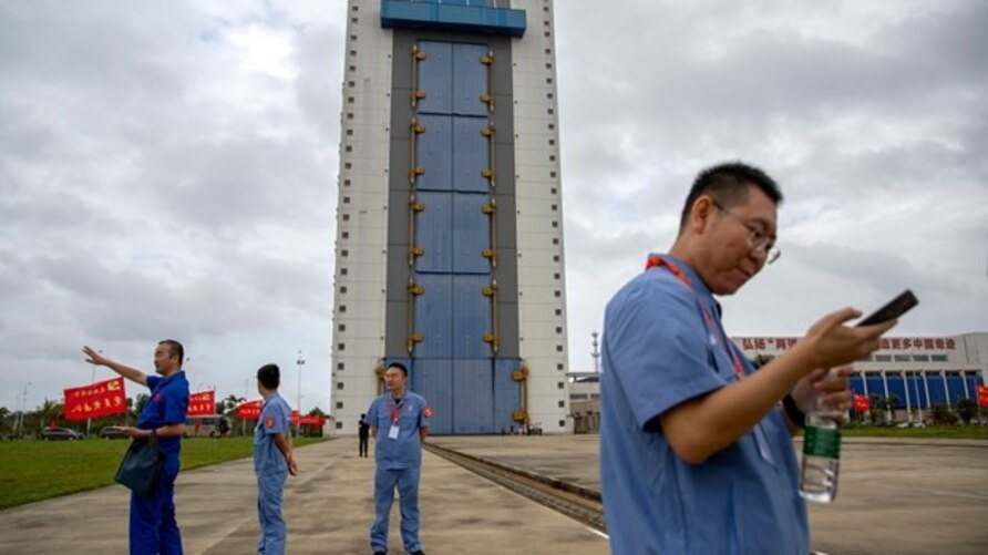 Workers gather near a building at the Wenchang Space Launch Site in Wenchang in southern China's Hainan province, Nov. 23, 2020.