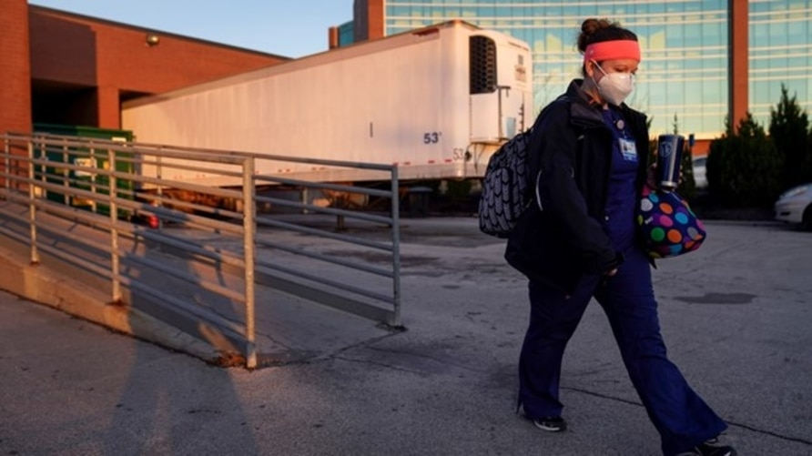 Nurse Jessica Franz leaves the Olathe Medical Center after working the graveyard shift Thanksgiving Day Nov 26, 2020 that she is celebrating without her mother-in-law, Elaine Franz, who died of the coronavirus on Nov. 10, a day before her 78th birthday.