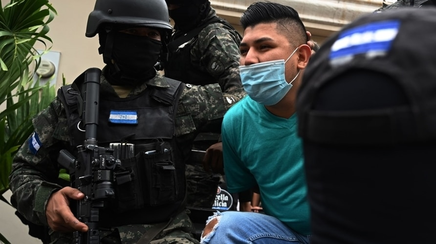 Members of the National Anti Maras and Gangs Force (FNAMP) arrest Jose Alejandro Nunez Cruz, alleged administrator of the criminal gang MS-13 at an exclusive residential area in Tegucigalpa, Honduras, Nov. 26, 2020.