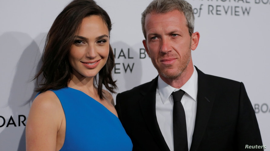 Actor Gal Gadot arrives with her husband, Yaron Varsano, to attend the National Board of Review awards gala in New York, U.S.,…