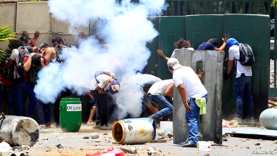 Students from the Universidad Agraria (UNA) public university protest against reforms that implement changes to the pension…