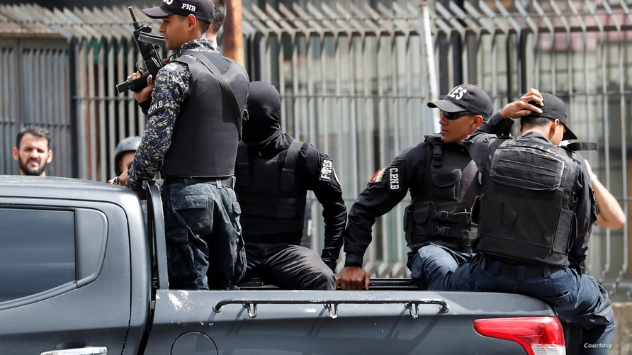 Members of Venezuela's Special Action Forces (FAES) ride in the back of a pick-up truck in Caracas, Venezuela July 5, 2019…