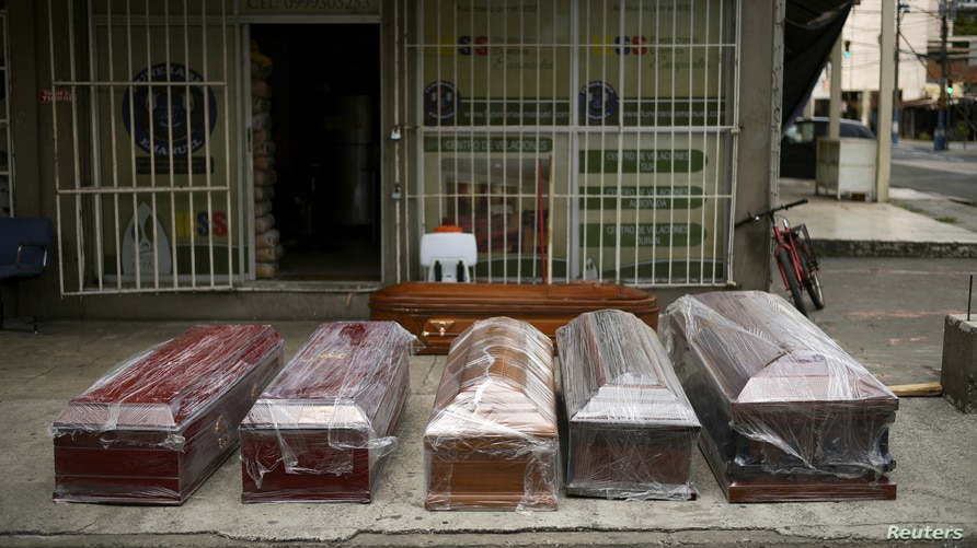 Empty coffins for sale are on display outside a funeral parlour, amidst the outbreak of the coronavirus disease (COVID-19), in…