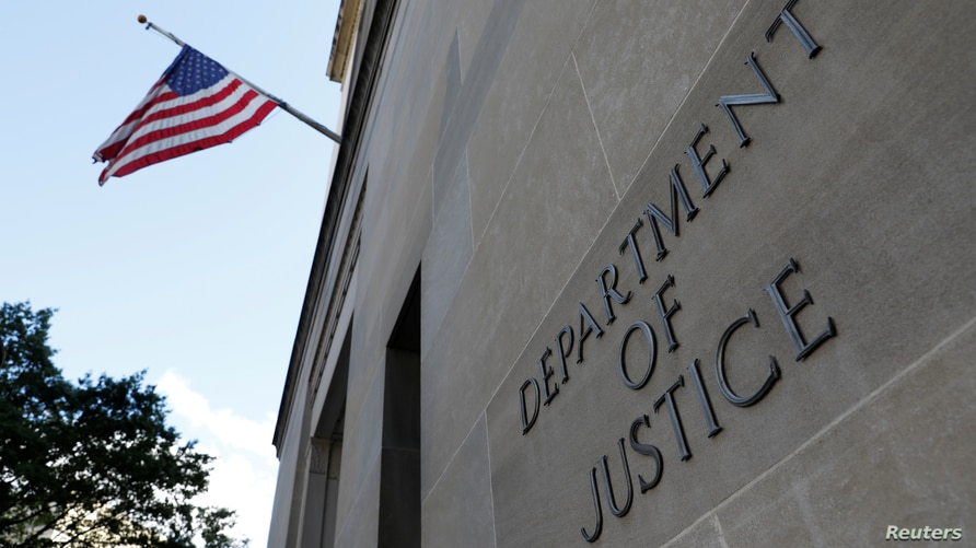 FILE PHOTO: Signage is seen at the United States Department of Justice headquarters in Washington, D.C., U.S., August 29, 2020…