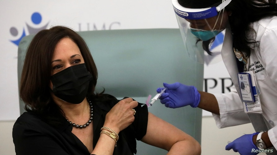 U.S. Vice President-elect Kamala Harris receives a dose of the Moderna COVID-19 vaccine at United Medical Center in Washington,…