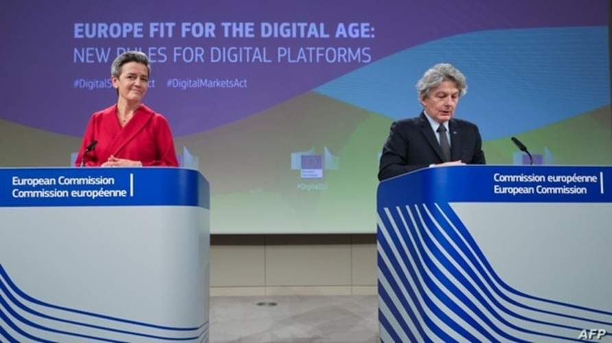 Executive Vice President of the European Commission for A Europe Fit for the Digital Age Margrethe Vestager, left, and European Commissioner for Internal Market Thierry Breton attend an EC press conference in Brussels, Dec. 15, 2020.