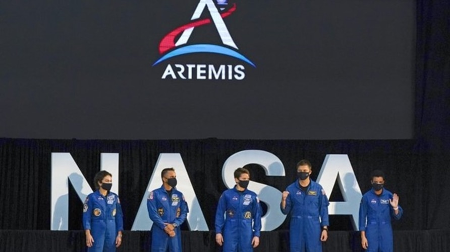 Five of the astronauts that will be part of the Atremis missions, from left, Jessica Meir, Joe Acaba, Anne McClain, Matthew Dominick, and Jessica Watkins are introduced by Vice President Mike Pence during the eighth meeting of the National Space Council at the Kennedy Space Center Wednesday, Dec. 9, 2020, in Cape Canaveral , Fla. (AP Photo/John Raoux)   1 of 7 Five of the astronauts that will be part of the Atremis missions, from left, Jessica Meir, Joe Acaba, Anne McClain, Matthew Dominick, and Jessica W