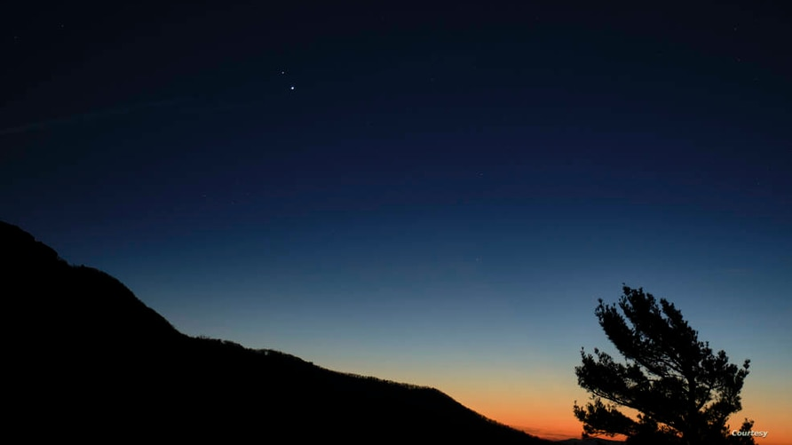 Saturn, top, and Jupiter, below, are seen after sunset from Shenandoah National Park, Sunday, Dec. 13, 2020, in Luray, Virginia…