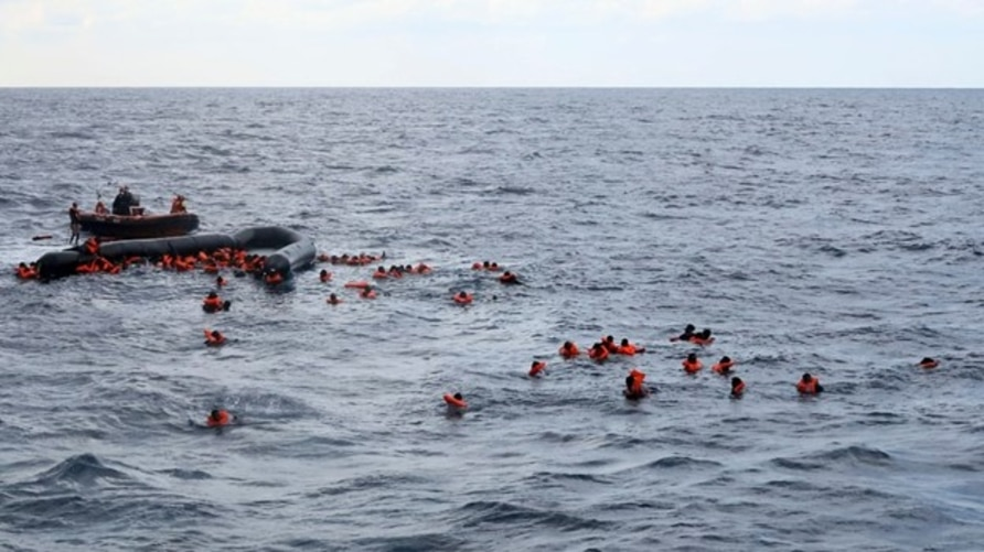 Refugees and migrants are rescued by members of the Spanish NGO Proactiva Open Arms, after leaving Libya trying to reach European soil aboard an overcrowded rubber boat in the Mediterranean sea, Nov. 11, 2020.