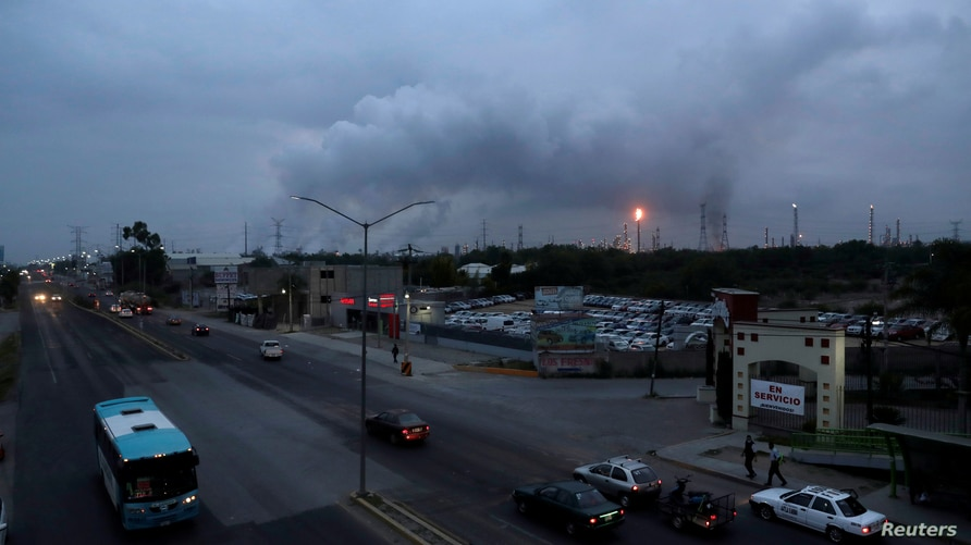 Excess natural gas is burnt, or flared, in the distance from Mexican state-run Pemex's Tula oil refinery as seen from a …