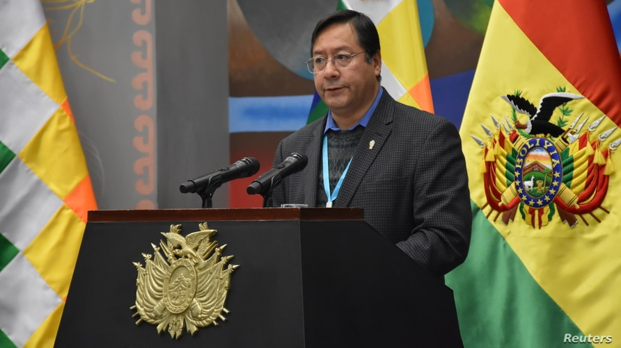 Bolivia's President Luis Arce speaks during a signing ceremony of an agreement with Russia for supplying 2.6 million doses of…
