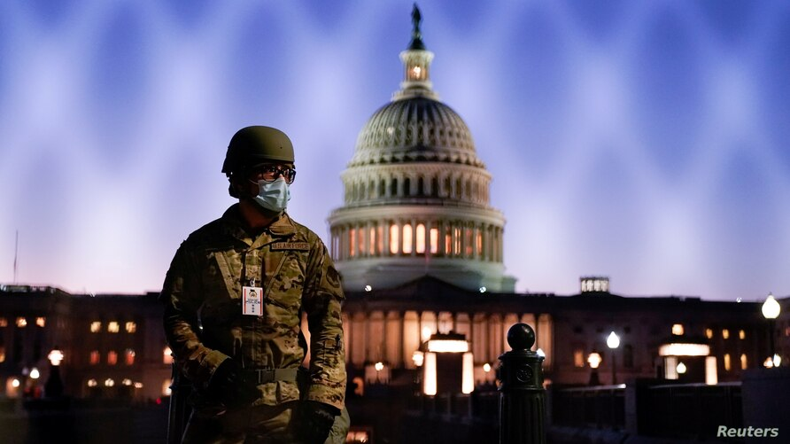 FILE PHOTO: Members of the National Guard gather at the U.S. Capitol as the House of Representatives prepares to begin the…