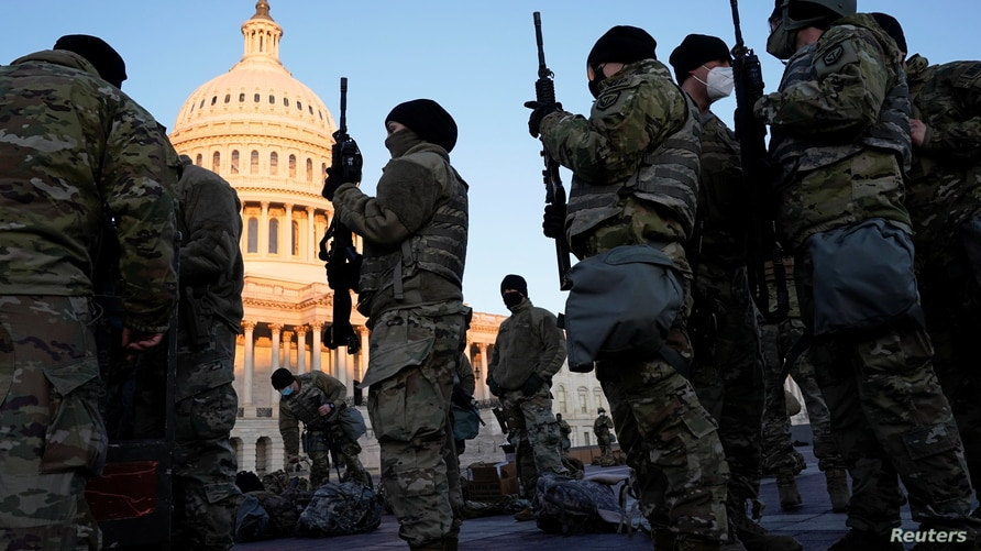 Members of the National Guard are given weapons before Democrats begin debating one article of impeachment against U.S…