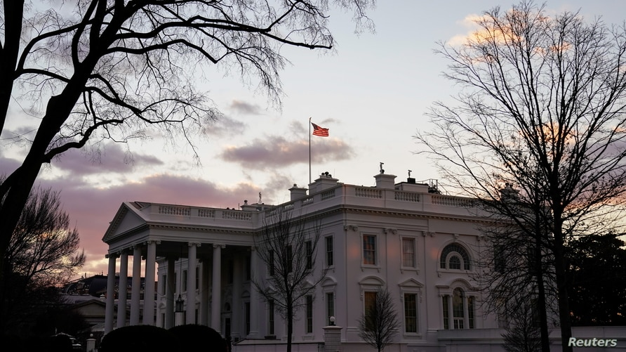 The White House is seen at sunrise during U.S. President Joe Biden's first week in office in Washington, U.S., January 23, 2021…