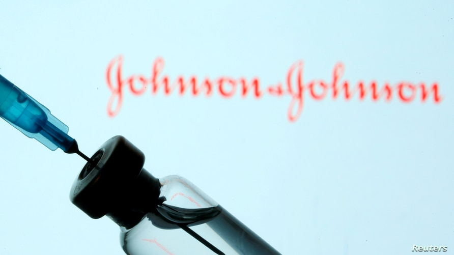 FILE PHOTO: A vial and sryinge are seen in front of a displayed Johnson&Johnson logo in this illustration taken January 11,…