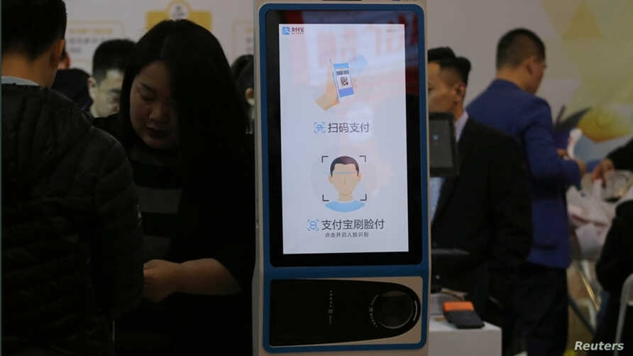 FILE - A machine with Alipay's facial recognition payment system is displayed at a smart business fair in Nanjing, Jiangsu province, China, March 21, 2019.