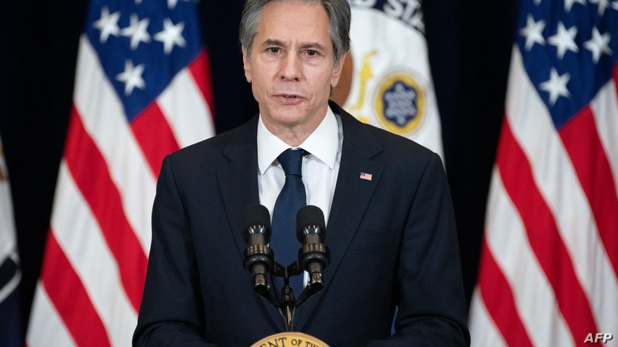 (FILES) In this file photo taken on February 4, 2021 US Secretary of State Antony Blinken speaks to staff at the US State…