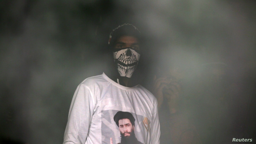 A man wearing a T-shirt with an image of Zakir Rashid Bhat also known as Zakir Musa, the leader of an al Qaeda affiliated…
