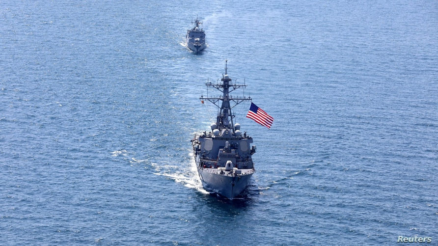 The U.S. Navy Arleigh Burke-class guided-missile destroyer USS Porter sails in formation during the multinational maritime…