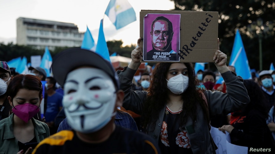 Demonstrators take part in a protest to demand the resignation of Guatemala's President Alejandro Giammattei in Guatemala City,…