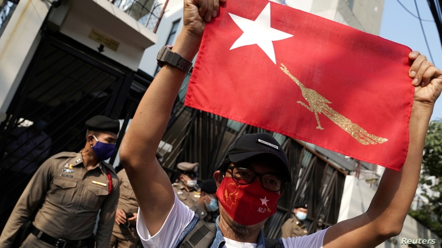 NLD supporter holds up the party's flag outside Myanmar's embassy during a rally after the military seized power from a…
