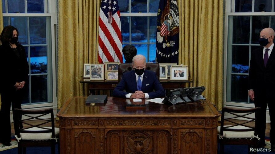 U.S. President Joe Biden prepares to sign executive orders on immigration at the White House in Washington, U.S., February 2,…