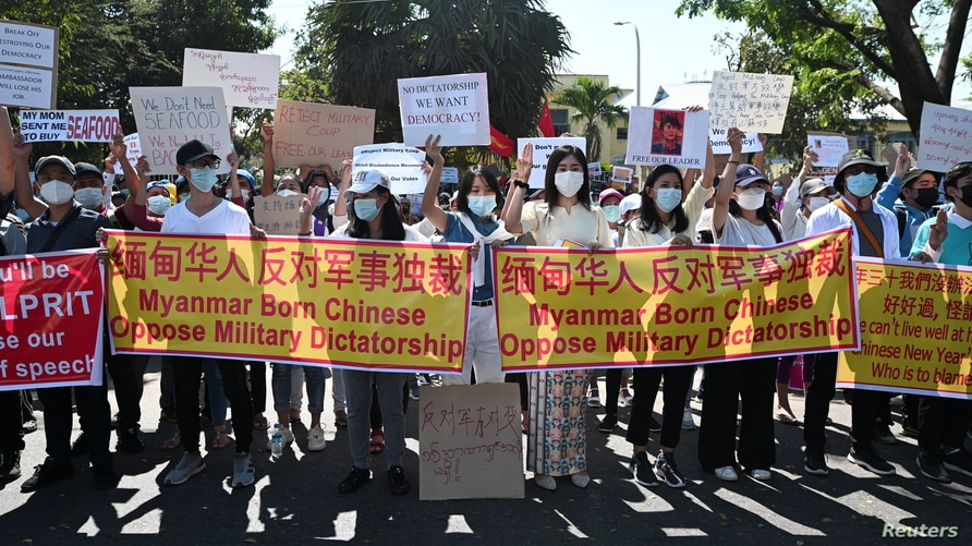 People gather outside the Chinese Embassy as they protest against the military coup and demand the release of elected leader…