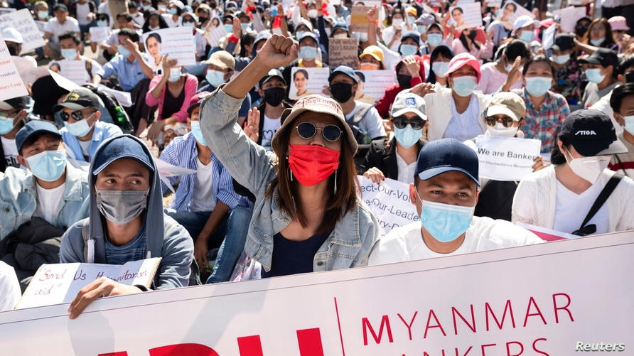 Demonstrators rally outside the Central Bank of Myanmar during a protest against the military coup and to demand the release of…