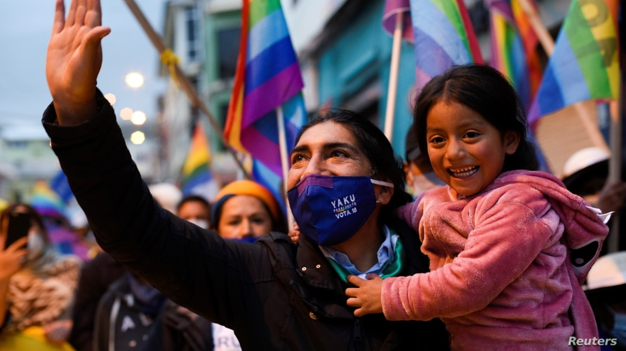 Ecuador's presidential candidate Yaku Perez greets supporters during a march with members of indigenous and supporters as they…