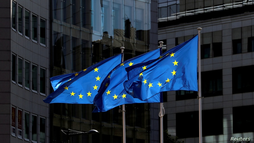 FILE PHOTO: European Union flags flutter outside the European Commission headquarters in Brussels, Belgium August 21, 2020…