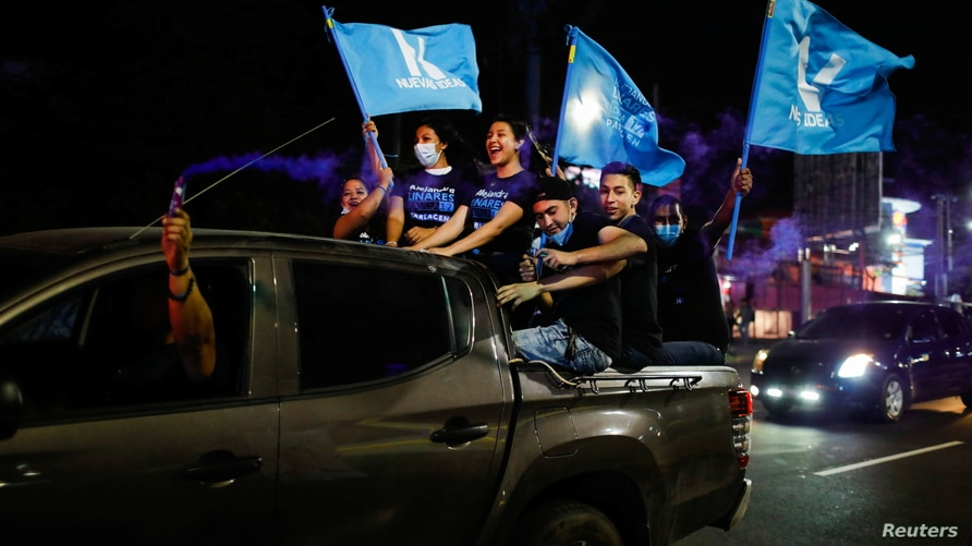 Supporters of the Nuevas Ideas political party cheer in a rally during the last day of election campaign in San Salvador, El…