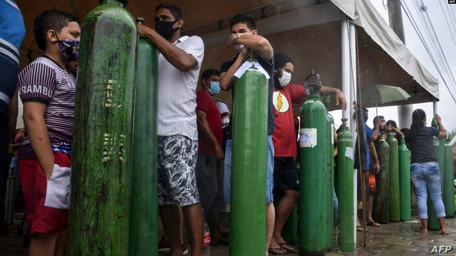 Relatives of COVID-19 patients queue for long hours to refill their oxygen tanks in Manaus, Amazonas state, on January 19, 2021.