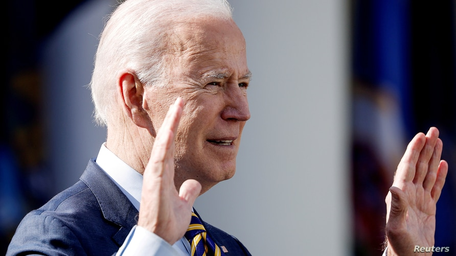 """FILE PHOTO: U.S. President Joe Biden speaks about the $1.9 trillion """"American Rescue Plan Act""""  during an event to celebrate…"""