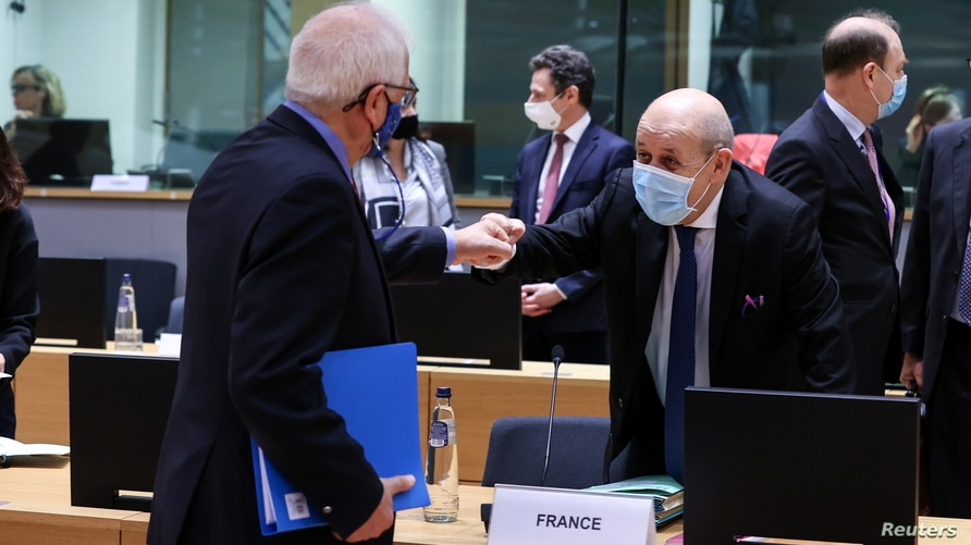 French Foreign Affairs Minister Jean-Yves Le Drian talks with European Union Minister for Foreign Affairs Josep Borrell before…