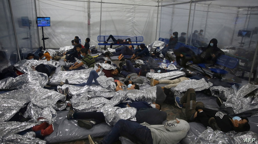 Young children rest inside a pod at the Donna Department of Homeland Security holding facility, the main detention center for…