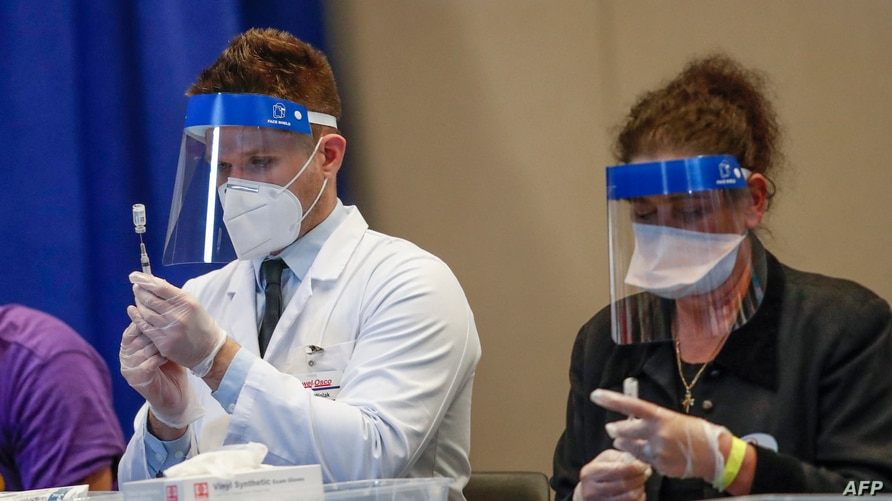 Medical workers prepare doses of the Johnson & Johnson Covid-19 vaccine at the International Union of Operating Engineers Local…