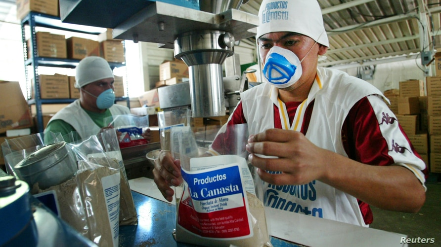 A Salvadoran worker packs products at a company that exports local food and drinks to Salvadorans living in the U.S. in San…
