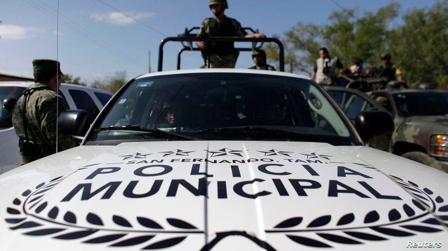 Soldiers use a pickup truck of the local municipal police in San Fernando, in the Mexican state of Tamaulipas, December 20,…