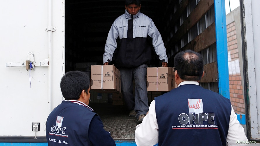 Peru's National Office of Electoral Processes (ONPE) workers carry ballot boxes and voting materials to a polling station…