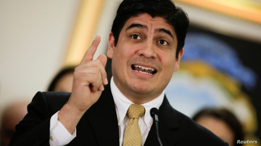 Costa Rica's President Carlos Alvarado Quesada, gestures as he speaks to the media after the resignation of his Minister of the…