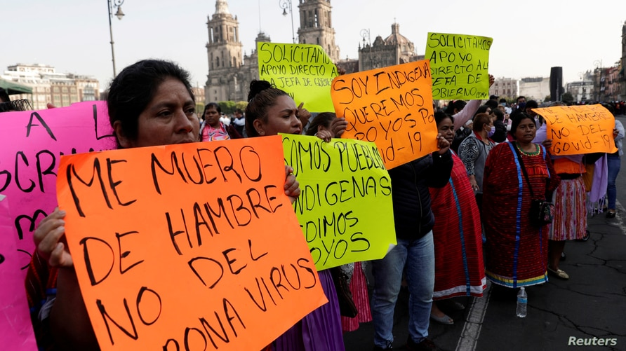Oaxaca's artisans take part in a protest outside the National Palace to demand the federal government help for the loss of jobs…