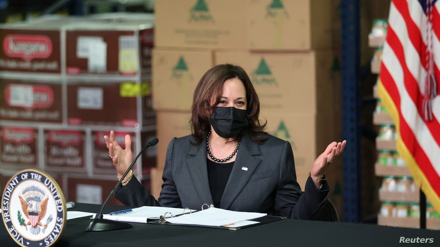 U.S. Vice President Kamala Harris speaks during a meeting with local leaders as she visits Feeding Northeast Florida food…