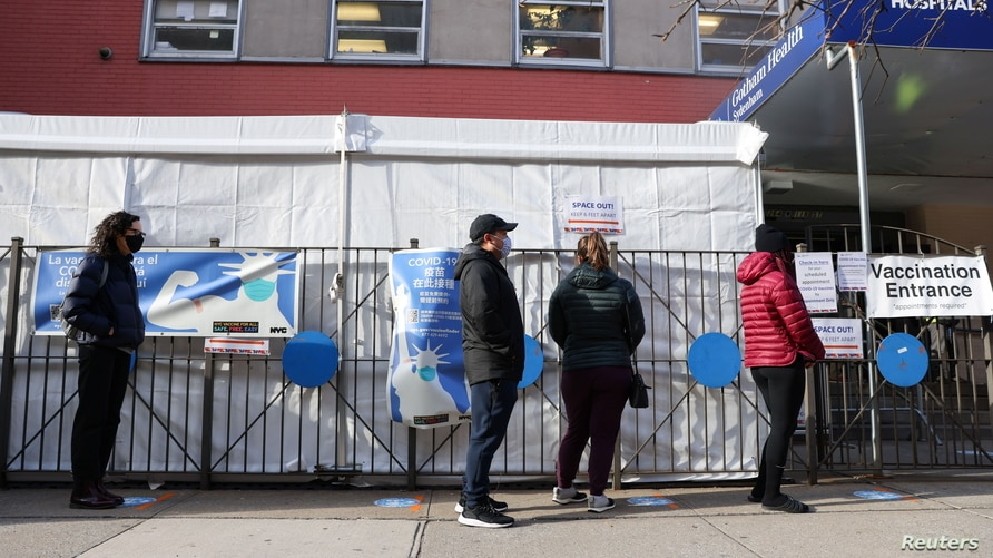 Naomi Hassebroek waits in line to receive her second COVID-19 vaccine at NYC Health+Hospitals Gotham Health Sydenham, in the…