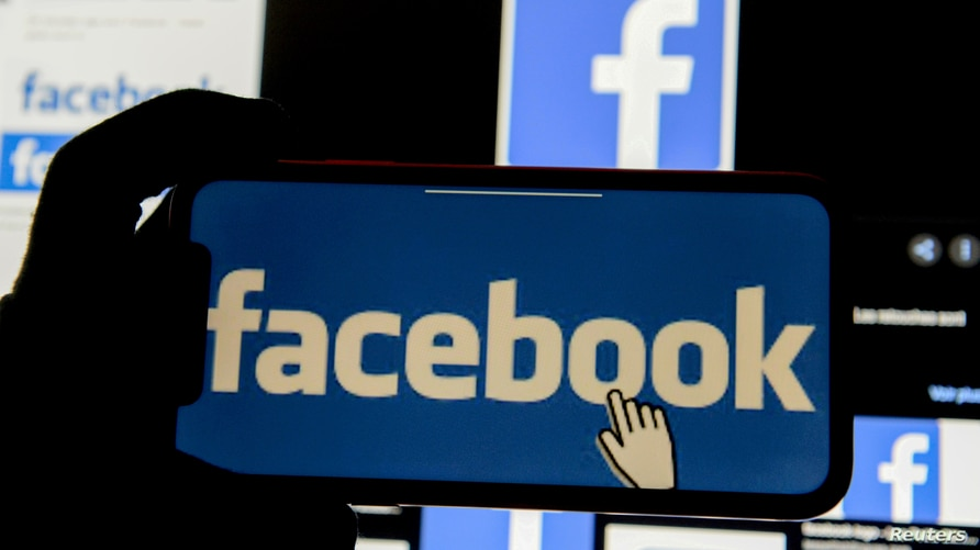 FILE PHOTO: The Facebook logo is displayed on a mobile phone in this picture illustration taken December 2, 2019. REUTERS…