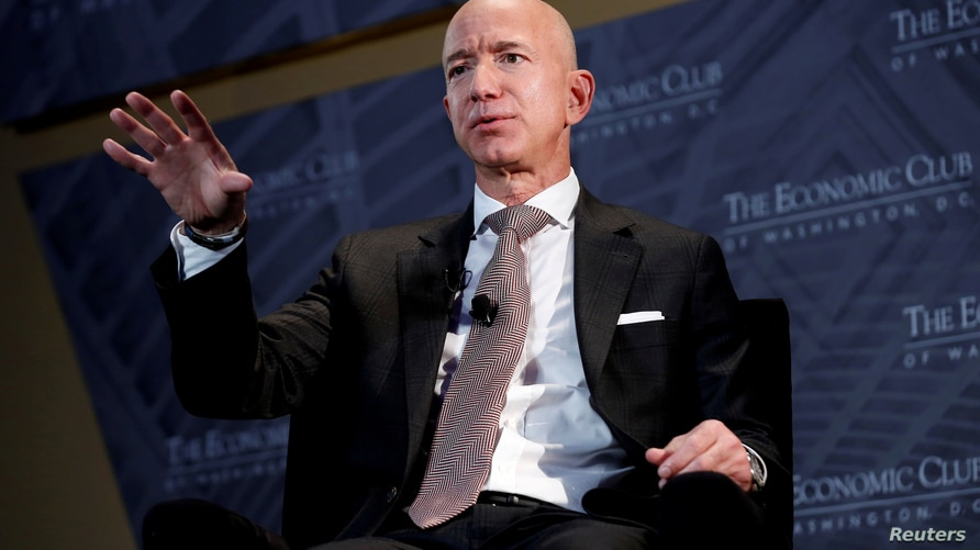 FILE PHOTO: Jeff Bezos, president and CEO of Amazon and owner of The Washington Post, speaks at the Economic Club of Washington…
