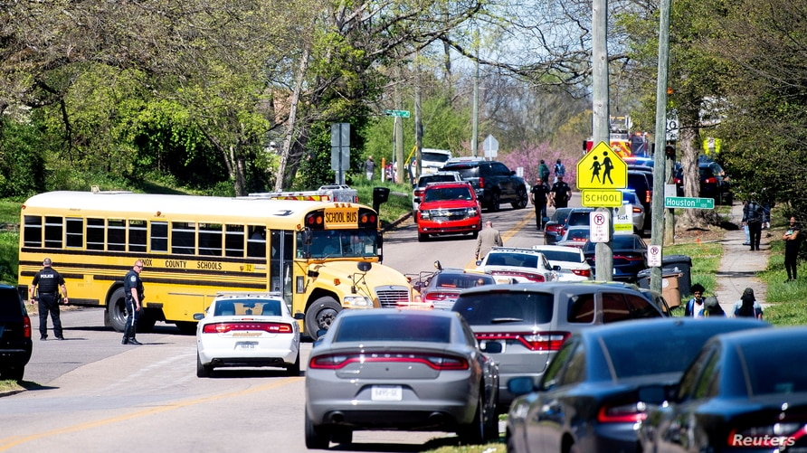 Police attend a shooting at Austin-East Magnet High School in Knoxville, Tennessee, U.S. April 12, 2021.   Brianna Paciorka…