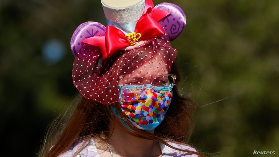 A person is seen outside Disneyland Park on its reopening day amidst the coronavirus disease (COVID-19) outbreak, in Anaheim,…